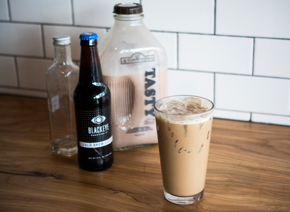 A Quixotic Coffee signature, the DeNiro, is a drink consisting of Blackeye Nitro Cold Brew, chocolate milk, almond simple syrup and ice.