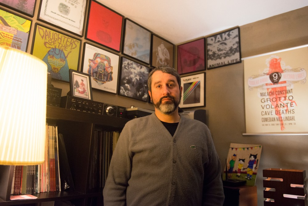 Tom Loftus poses for portraits in the office of his record label, Modern Radio, on Jan. 20. The label, which includes such bands as Hollow Boys, STNNNG, Fury Things and B.O.Y.F., is celebrating its 16th birthday with two shows this weekend.