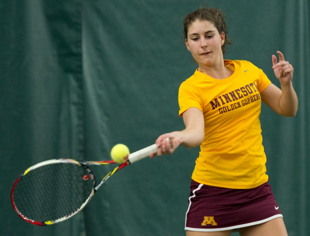 Gophers senior Paula Rincon-Otero returns the ball to South Dakota in the Baseline Tennis Center on Saturday evening.