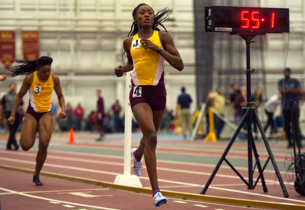 Junior Titania Markland crosses the finish line, placing first in the 400 meter dash during the Jack Johnson Classic at the Field House on Saturday.