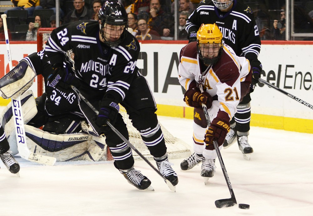 Forward Connor Reilly fights for the puck at the Xcel Energy Center in St. Paul on Sunday, where the Gophers lost to the MSU-Mankato Mavericks 3-2 on day-two of the North Star College Cup.