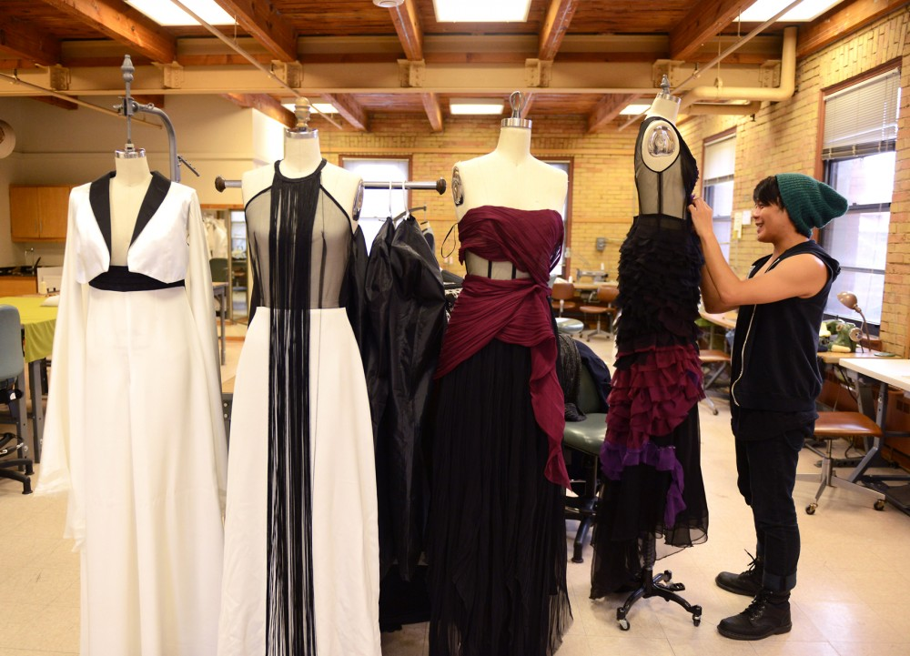 Apparel design major Lee Tran makes final alterations to his four-piece collection for the upcoming senior fashion show,