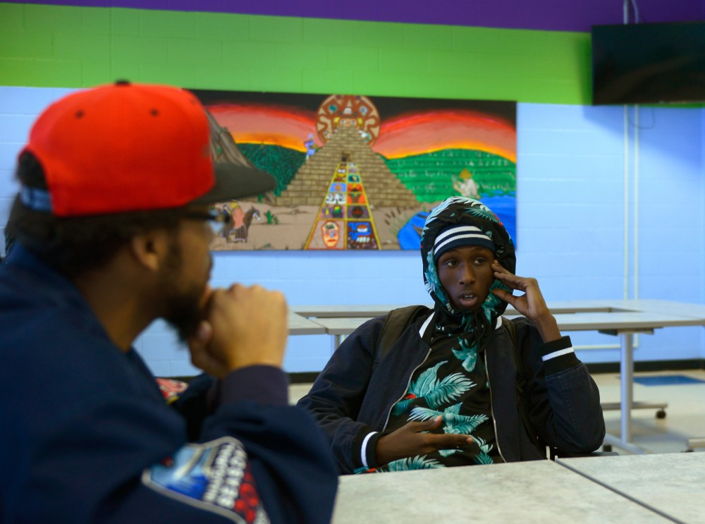 West Bank Community Coalition's youth and Young Adult Organizer Burhan Mohumed listens as Ayub Abdi explains why he decided to be part of the podcast at the Pillsbury United Communities' Brian Coyle Center Tuesday. Abdi said he was frustrated to the point where he had to speak out.
