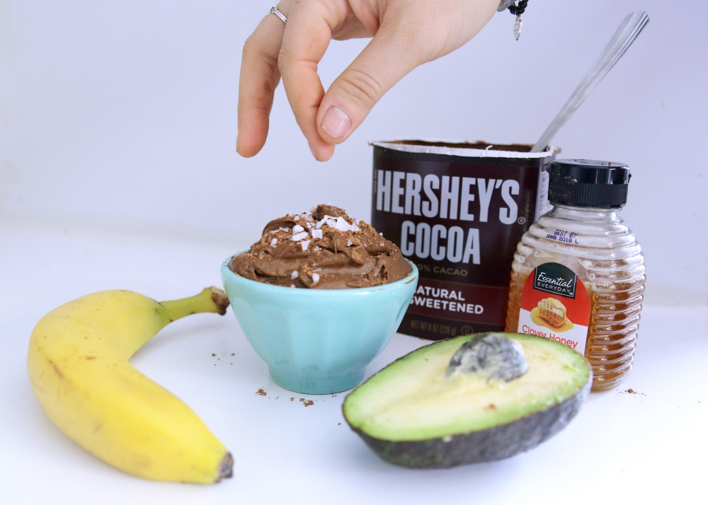 Simple, creamy and nutritionally-dense, this chocolate peanut butter avocado pudding, garnished with cocoa powder and sea salt, is a minimalist bakers dream.