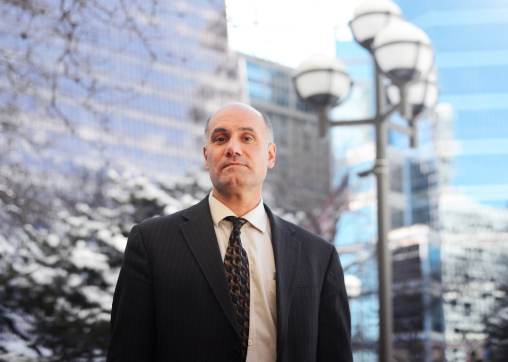 Attorney Jordan Kushner poses for portraits outside the Government Center in downtown Minneapolis on Wednesday. Kushner is being charged with three misdemeanors after filming police officers at a protest that occurred during a lecture at the University of Minnesota's Law School in November.