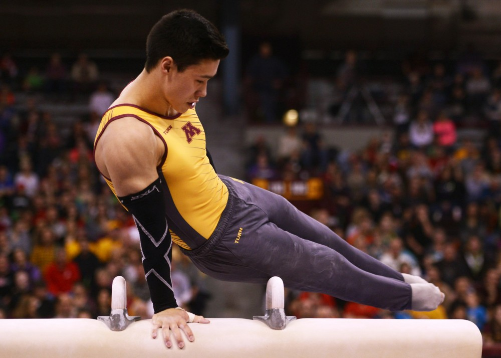 Freshman Justin Karstadt concentrates during his performance on the pommel horse at the Sports Pavilion on Saturday.