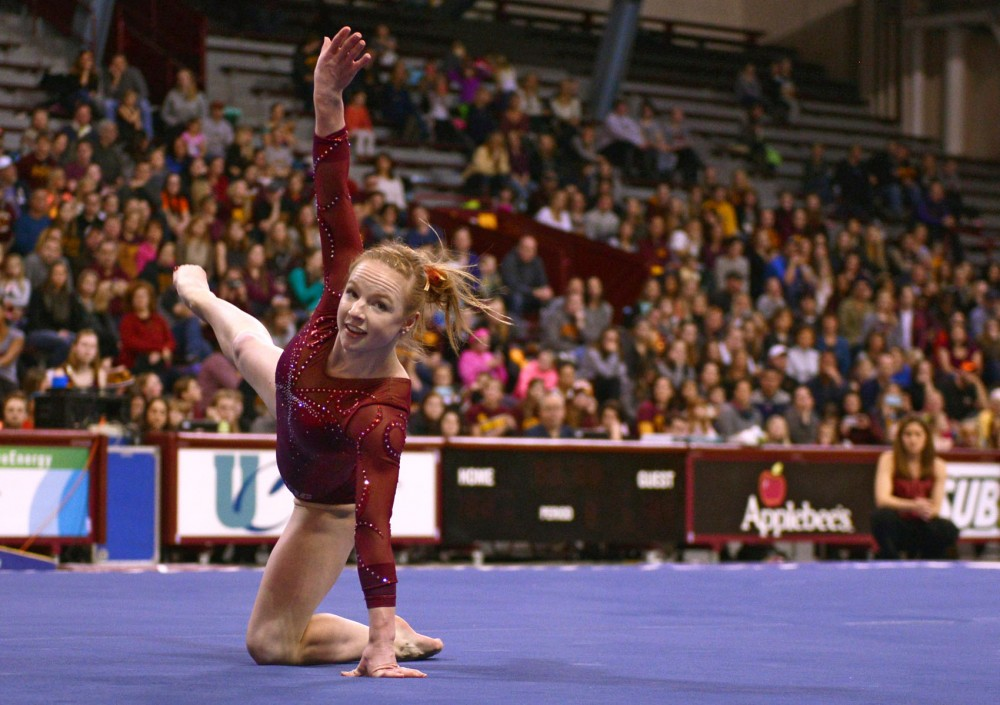 Lindsay Mable performs her floor routine during Saturday's competition against Illinois. Mable took first place on Uneven Bars, Beam, Floor and All-Around as the Gophers won their fifth straight meet.