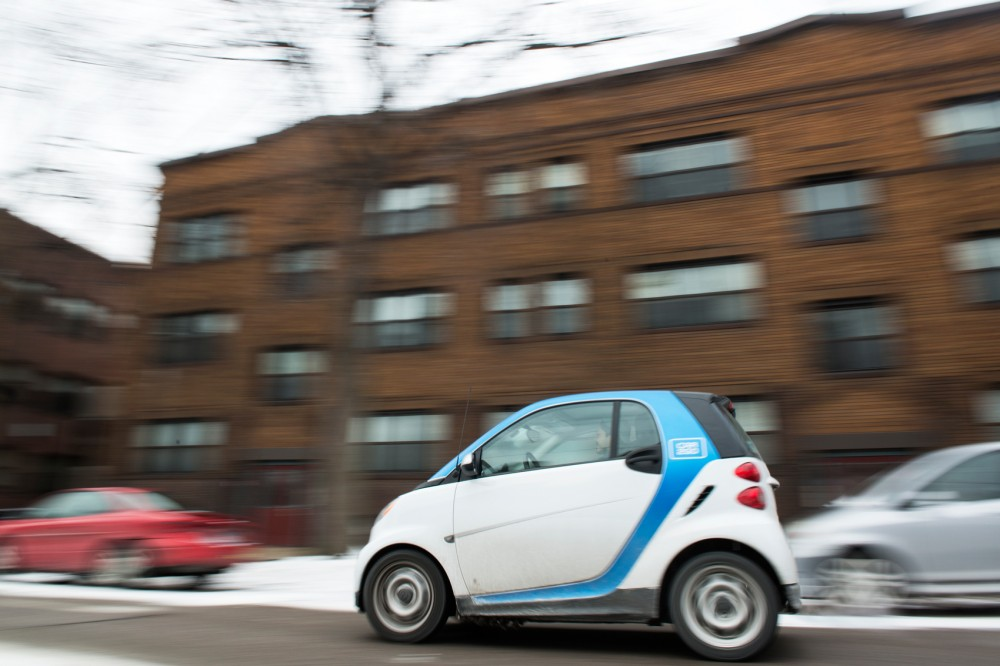 A Car2Go vehicle drives down Eighth Street Southeast in the Marcy-Holmes neighborhood on Monday. Currently there are 350 Car2Go cars in the city.