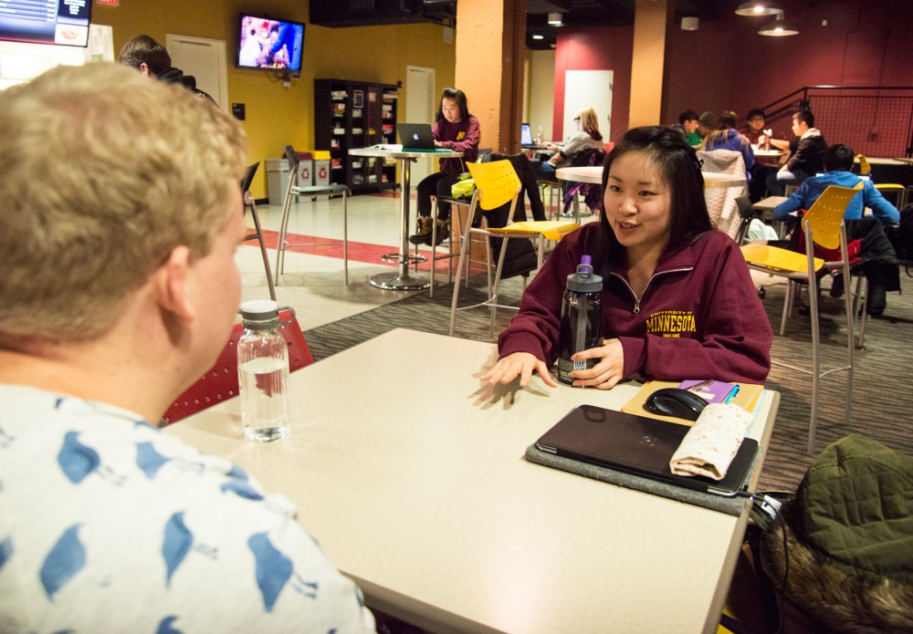 First Year Experience section leader Lucy Chen meets with freshman Steven King for a one-on-one check in at Goldy's Gameroom on Monday. As a freshman, Chen was encouraged by her FYE section leader to get involved with the program to help future incoming freshmen during their first year of college.
