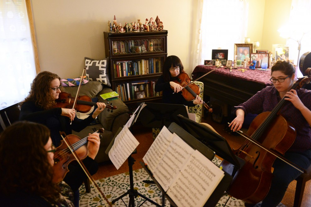 Musicians Huldah Niles, Erika Hoogeveen, Valerie Little and Ruth Marshall of the Mill City String Quartet rehearse on Sunday at Little's home in preparation for their upcoming concerts.