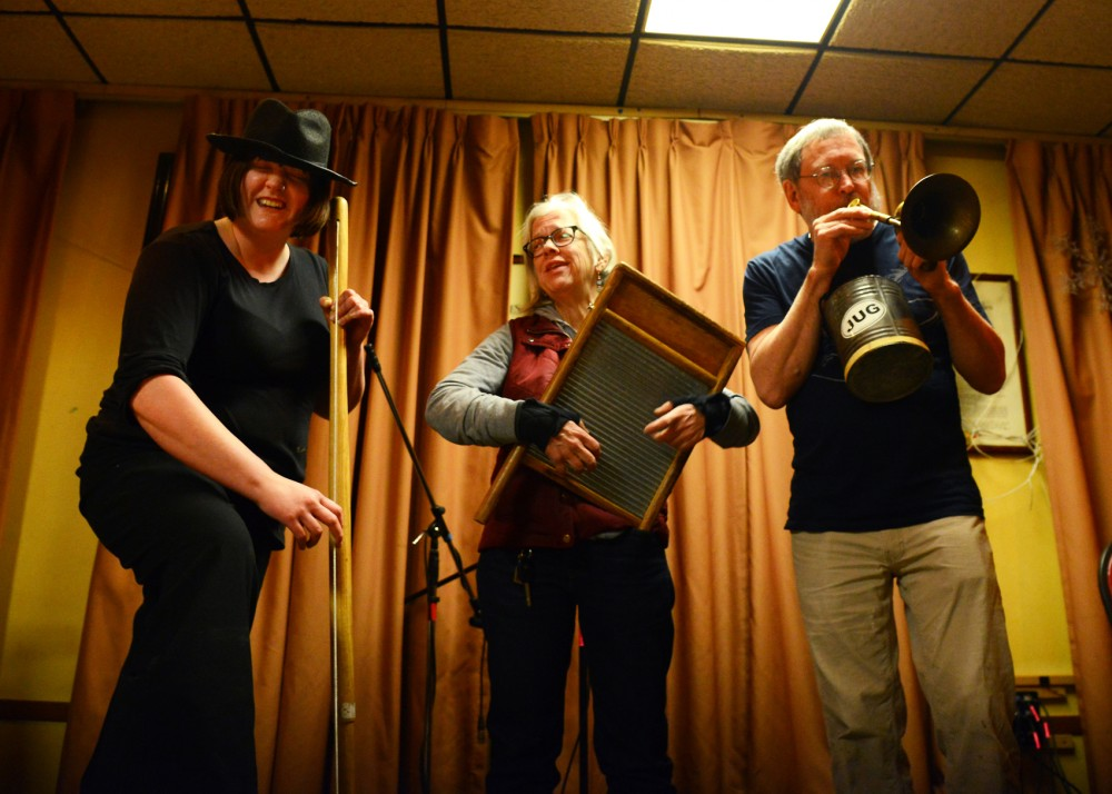 Jug band musicians, left to right, Amanda Standalone Nygard, Kris Garwick and Bob Fyfe play a song together at Eagles Club #34 on Friday, Feb. 5. This weekend marks the 34th annual Battle of the Jug Bands, which will be held at the Cabooze on Feb. 13 and 14.