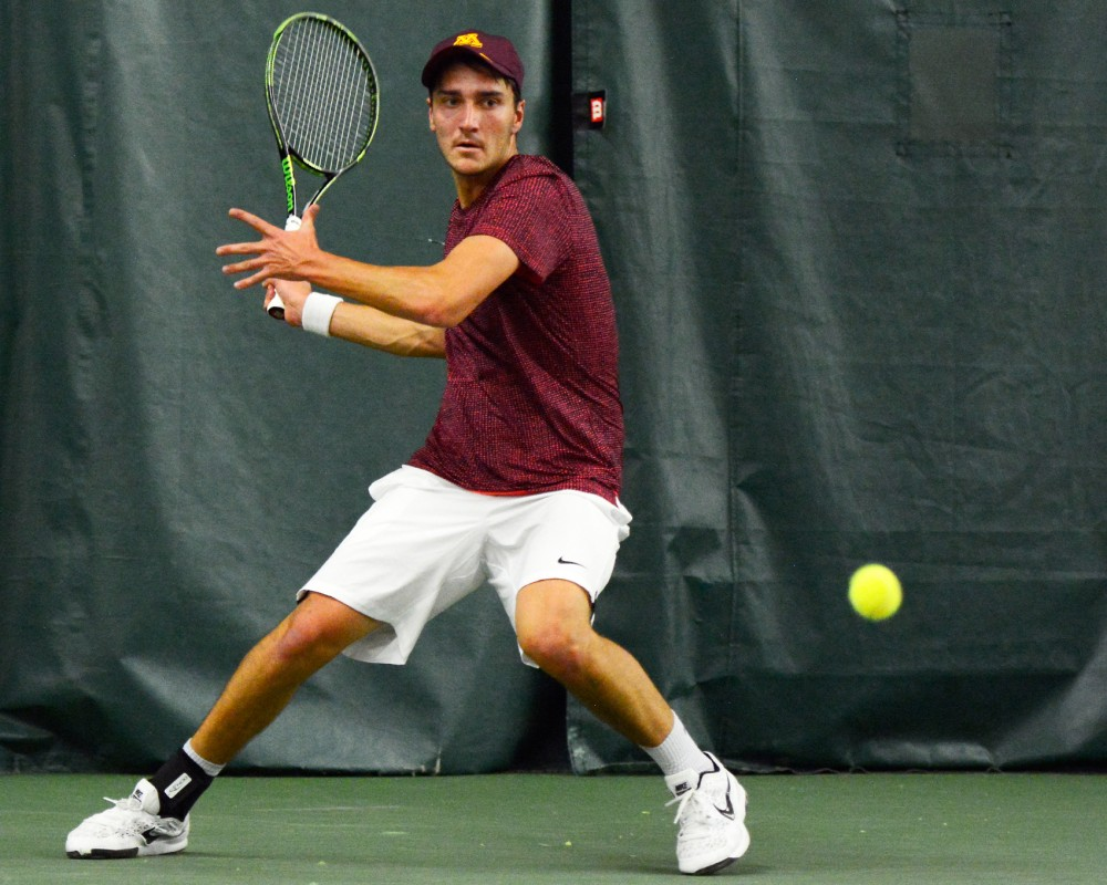 Gophers freshman Justyn Levin returns the ball to South Florida in the Baseline Tennis Center on Feb. 5.