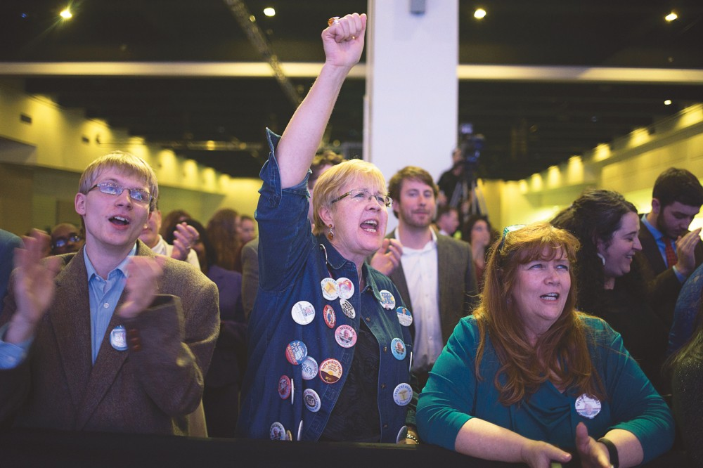 Bernie Sanders supporter Ellen Lafans of Eagan, center, cheers during his speech at the Fifth Annual Minnesota DFL Humphrey-Mondale Dinner fundraising event at the St. Paul RiverCentre on Friday.