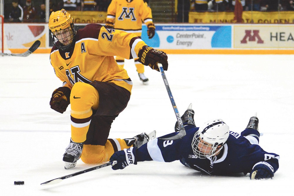Gophers forward Hudson Fasching fights to maintain control of the puck against Penn State in Mariucci Arena on Saturday night.