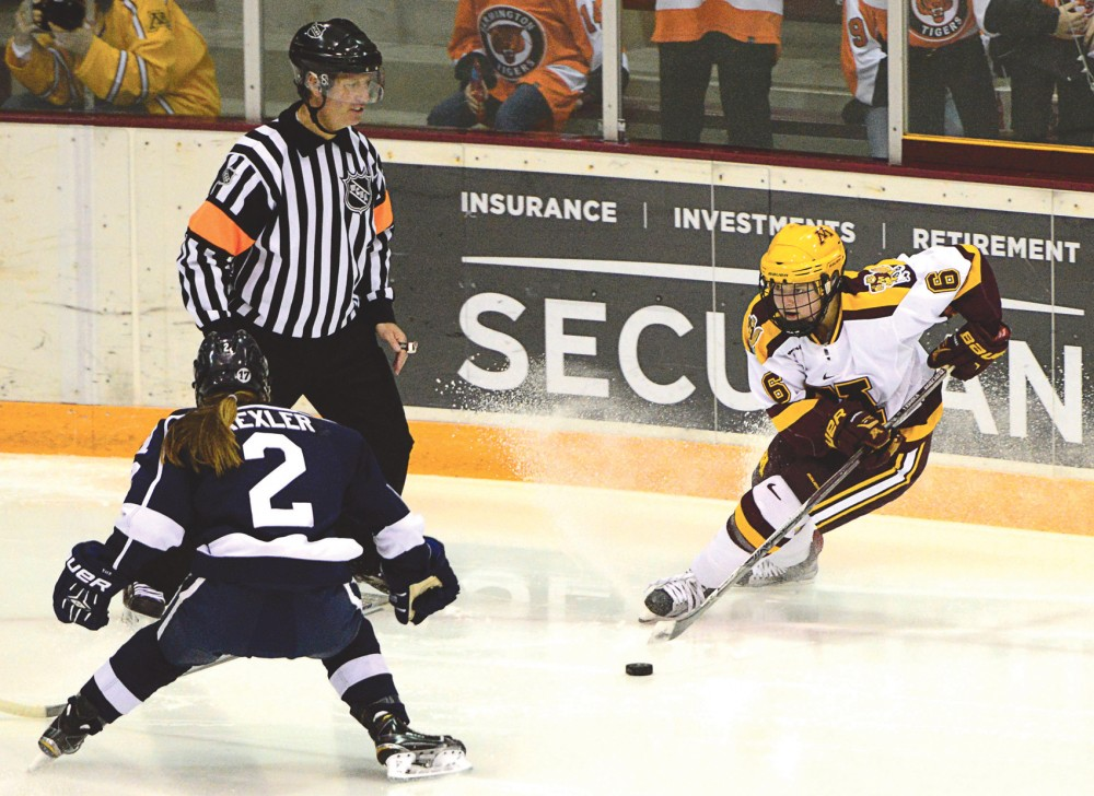Gophers forward Kate Schipper maneuvers the puck away from Yale in Ridders Arena on Nov. 20, 2015.