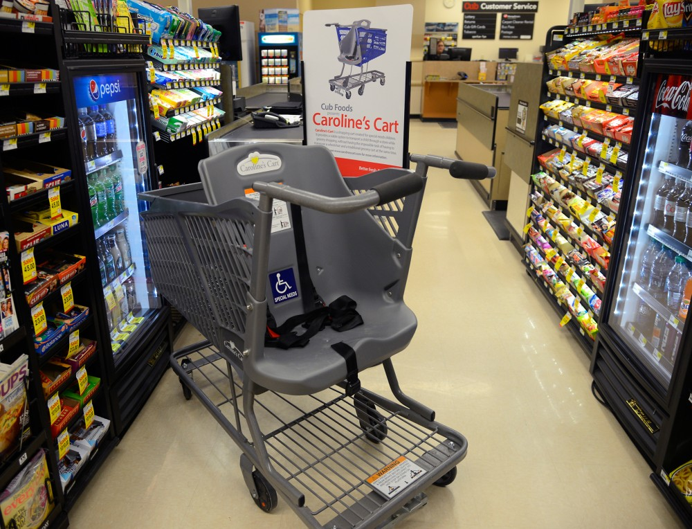 A Carolines Cart shopping cart sits on display at Cub Foods in the Quarry on Sunday. The carts are designed to accommodate families who have children with special needs, and will be added to Target stores across the country.