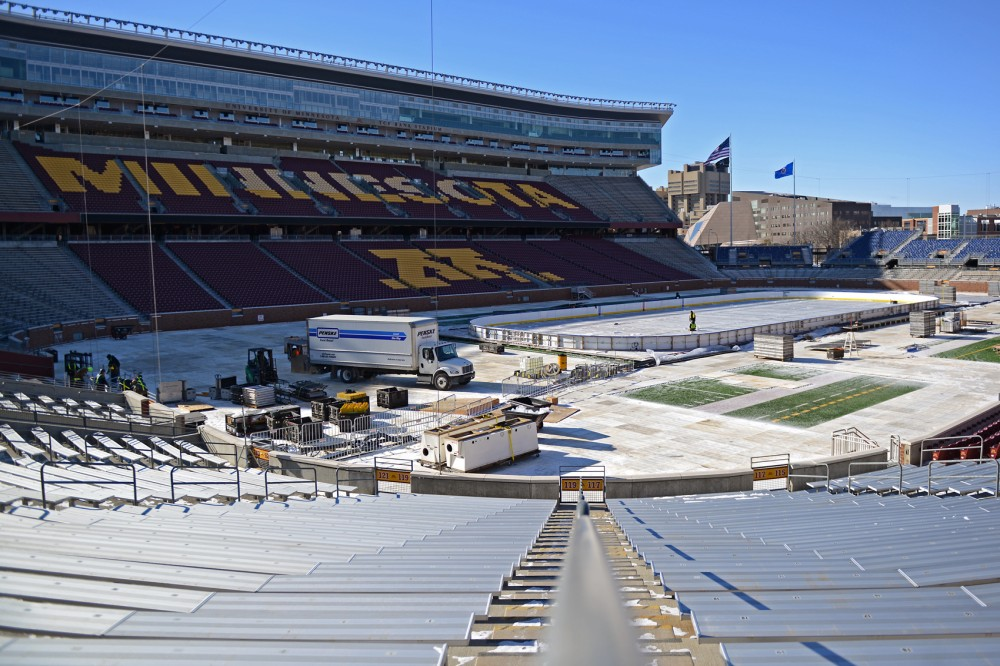 Crew members work to set up the hockey rink that will be used for the upcoming NHL Stadium Series game between the Minnesota Wild and Chicago Blackhawks inside TCF Bank Stadium on Feb. 21.