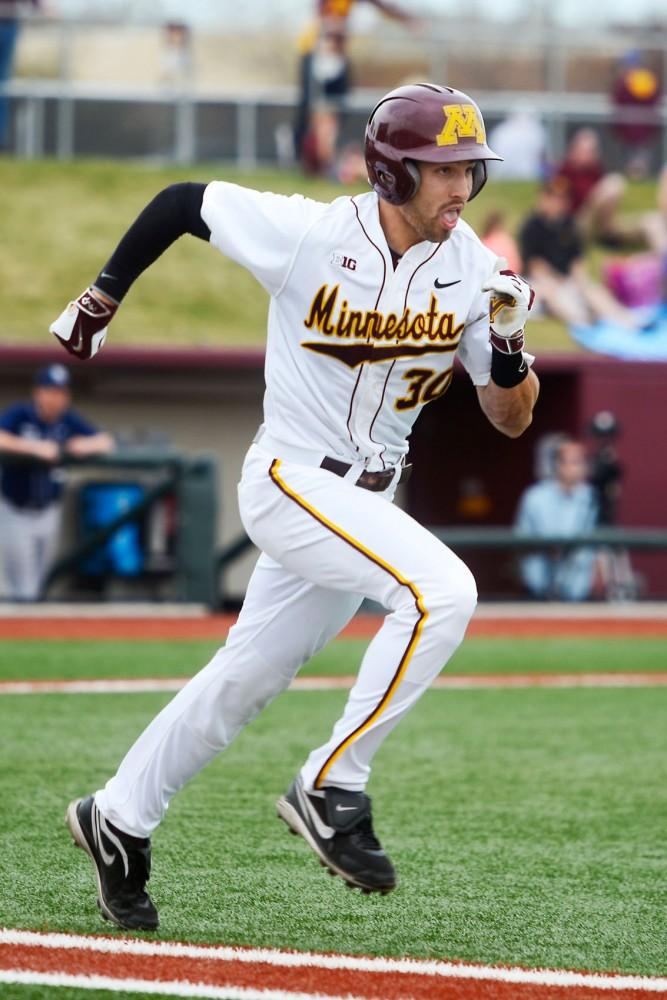 Senior outfielder Dan Motl sprints to first base at Siebert Field where the Gophers men's baseball team took on Penn State on April 18, 2015.