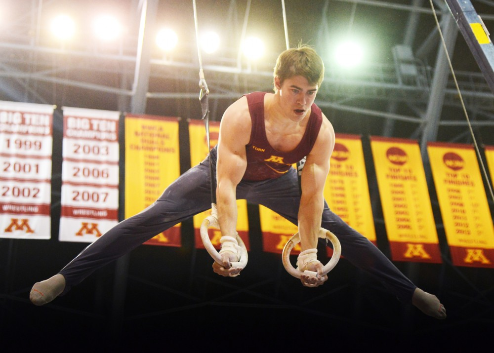 Sophomore Yaroslav Pochinka competes on the still rings at the Sports Pavillion on Saturday, Feb 13.