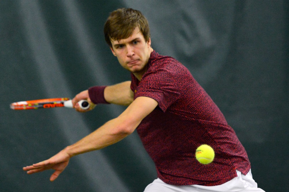 Gophers sophomore Matic Spec returns the ball to South Florida in the Baseline Tennis Center on Friday, Feb. 5.