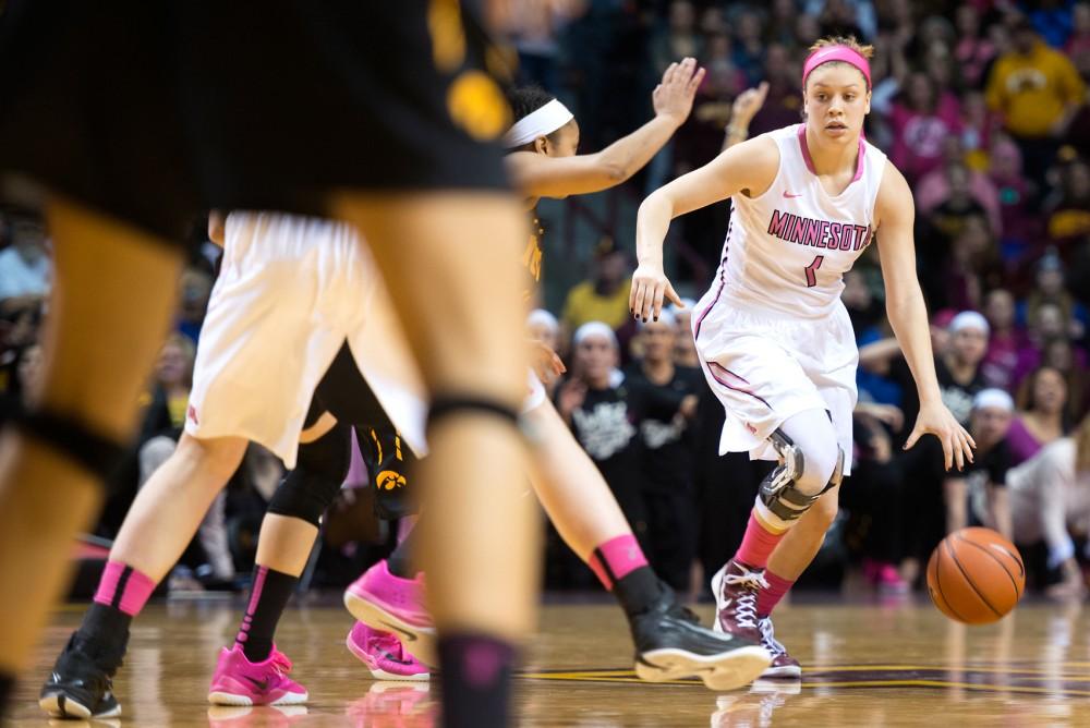 Minnesota guard Rachel Banham carries the ball at Williams Arena on Monday, Feb. 15. Banham scored the winning basket to defeat Iowa 78-76.
