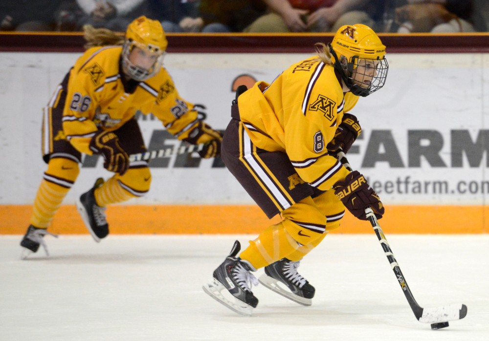 Gophers forward Amanda Kessel controls the puck while playing against Wisconsin in Ridders Arena on Saturday afternoon.