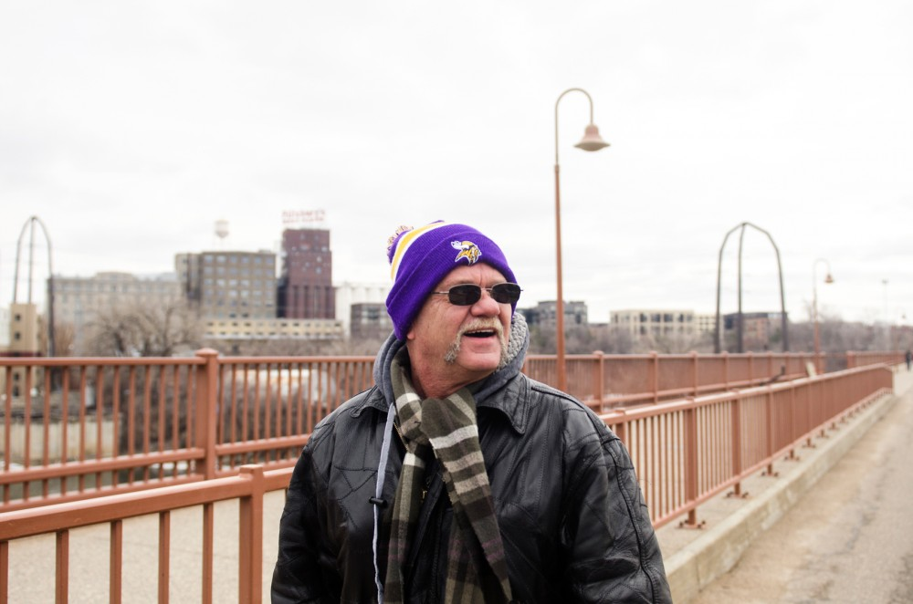 Minneapolis resident Thomas Jones walks along the Stone Arch Bridge on Sunday afternoon. In November, Jones moved into the Arrigoni House West, a sober residence in the Marcy-Holmes neighborhood for men overcoming chemical addictions. Jones says going for walks are one of the frequent group activities he enjoys doing.