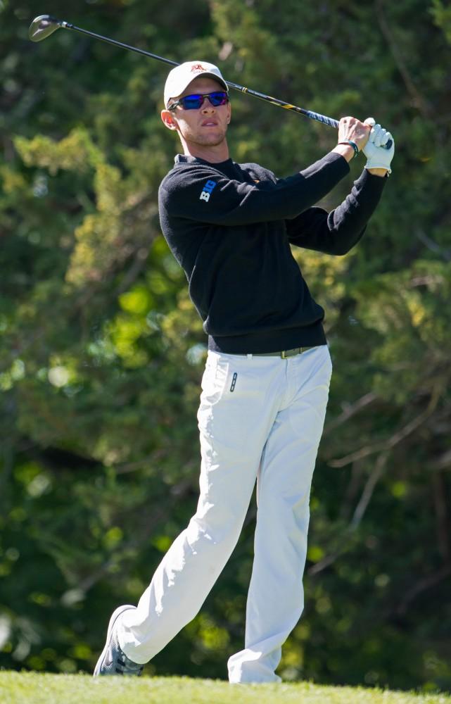 Senior Jon Dutoit drives the ball at the Windsong Golf Club on Sunday, Sept. 15, 2015.