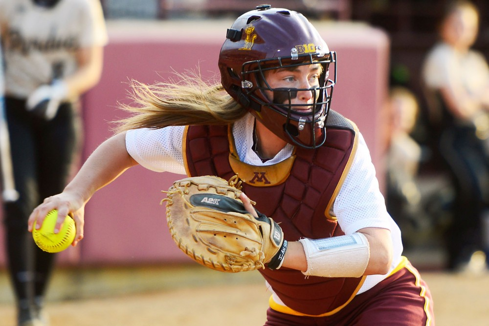 Minnesota catcher Taylor LeMay winds up to pass the ball at the Jane Sage Cowles Stadium on May 1, 2015.