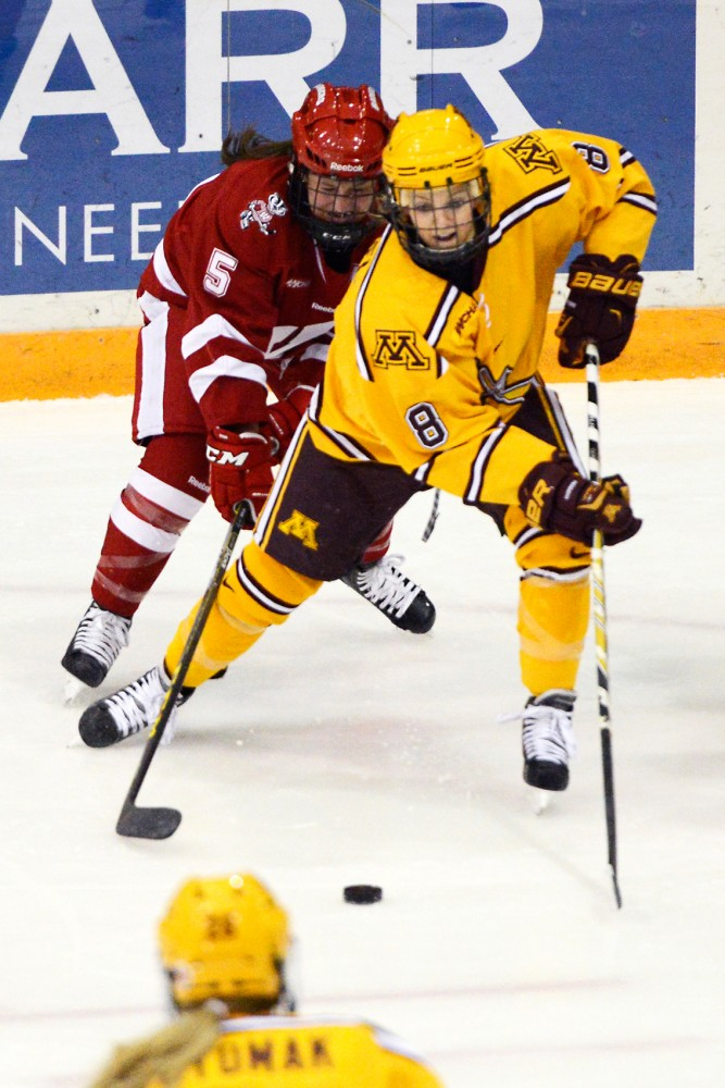 Gophers forward Amanda Kessel fights to maintain control of the puck while playing against Wisconsin in Ridders Arena on Saturday, Feb. 20.
