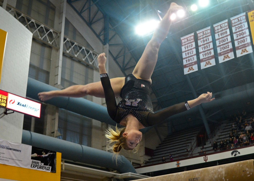 Senior Hanna Nordquist performs on the balance beam during Saturday's regular season finale at the Sports Pavilion. Nordquist scored a 9.850 on the beam, claiming second place.