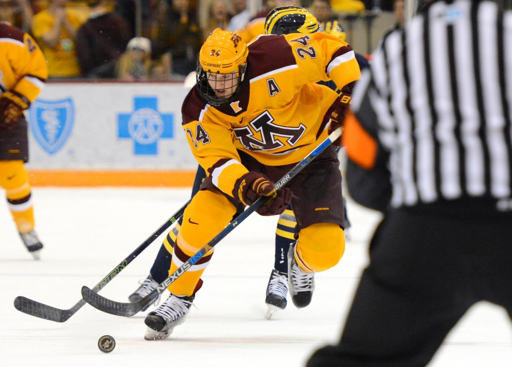 Gophers forward Hudson Fasching controls the puck while playing against Michigan in Mariucci Arena on Friday night.