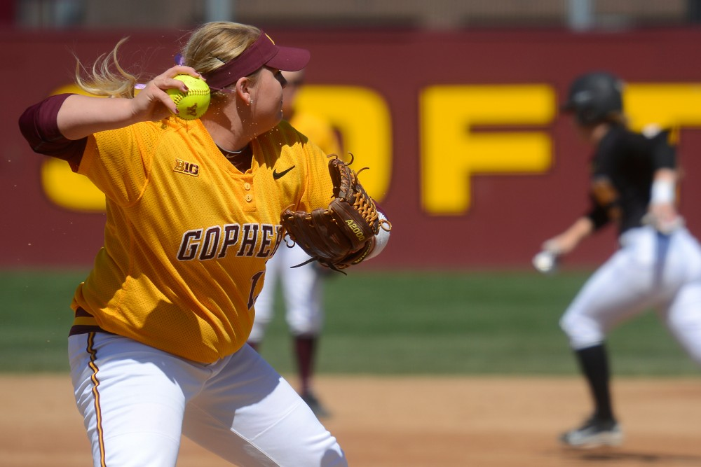 Gophers pitcher Sara Groenewegen readies to throw a player out at Jane Sage Cowles Stadium on April 26, 2015.