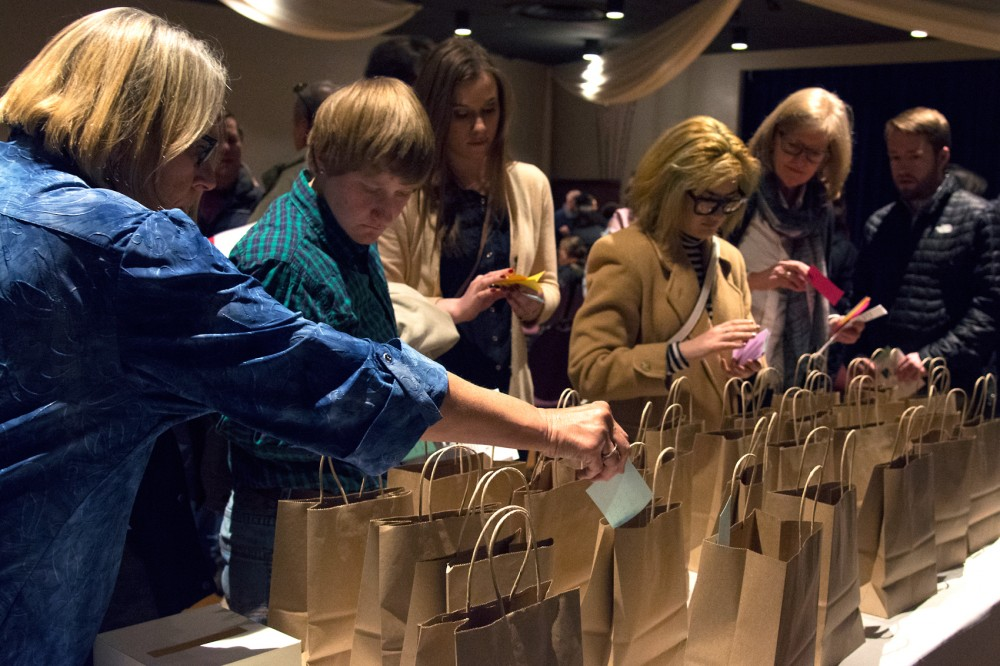 Attendees of Wednesday's Break the Silence event place messages of encouragement into bags for individuals who shared their personal stories of assault. Organized by Sarah Super, a rape survivor, Break the Silence events shed light on the realities of sexual assault and aim to empower victims.