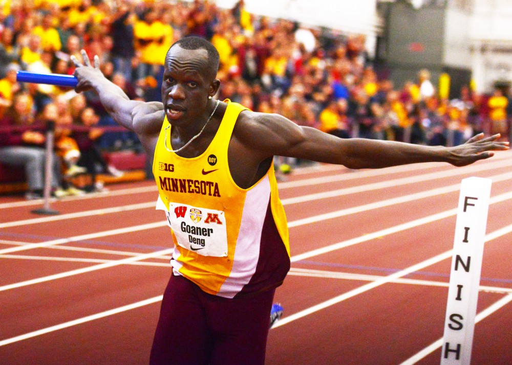 Senior Goaner Deng crosses the finish line of the men's 400-meter relay race at the University of Minnesota Field House on Jan. 23.