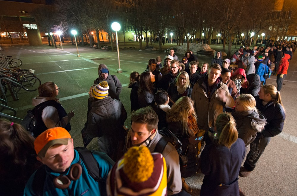 Caucus-goers wait in a line that spanned to the Wilson Library to attend the only GOP caucus on campus in Anderson Hall on Tuesday evening.