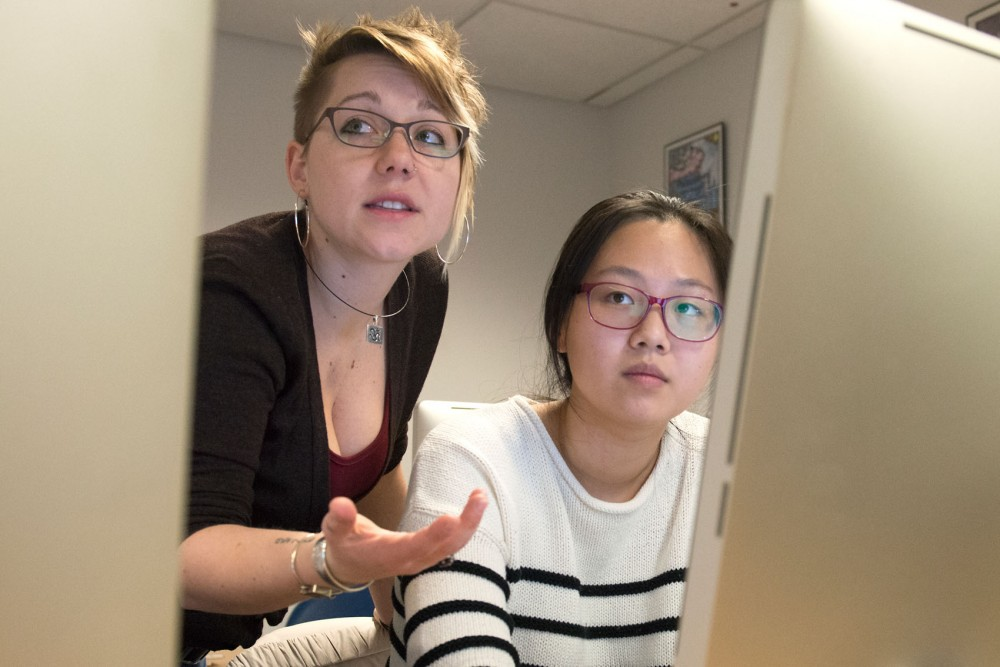 6th year PhD Candidate in Feminist Studies Angela Carter assists senior Anna Zhao on an assignment for a senior seminar course in the Gender, Women, and Sexuality Studies department in Ford Hall on Monday afternoon.