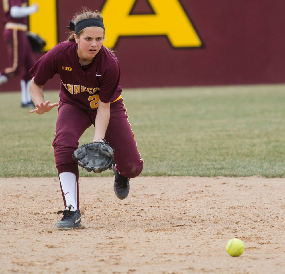 Sophomore Danielle Parlich fields a ground ball between innings at Jane Sage Cowles Stadium, April 4.