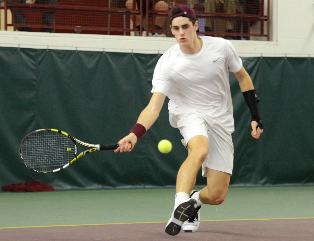 Sophomore Felix Corwin returns the ball to Illinois State in the Baseline Tennis Center on Feb. 27.