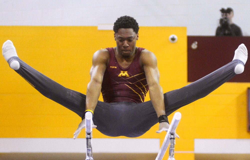 Senior Paul Montague Jr. competes on the parallel bars on Saturday at the Sports Pavilion.