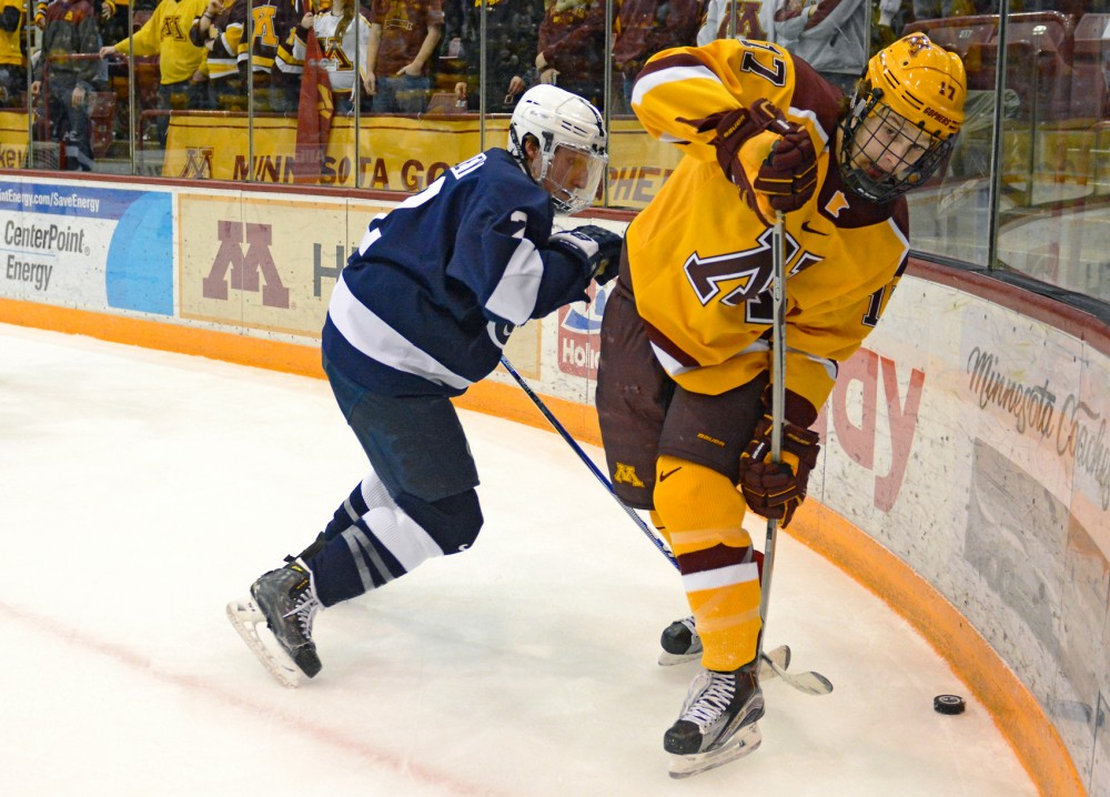 Gophers forward Tommy Novak fights to maintain control of the puck while playing against Penn State in Mariucci Arena on Saturday night.