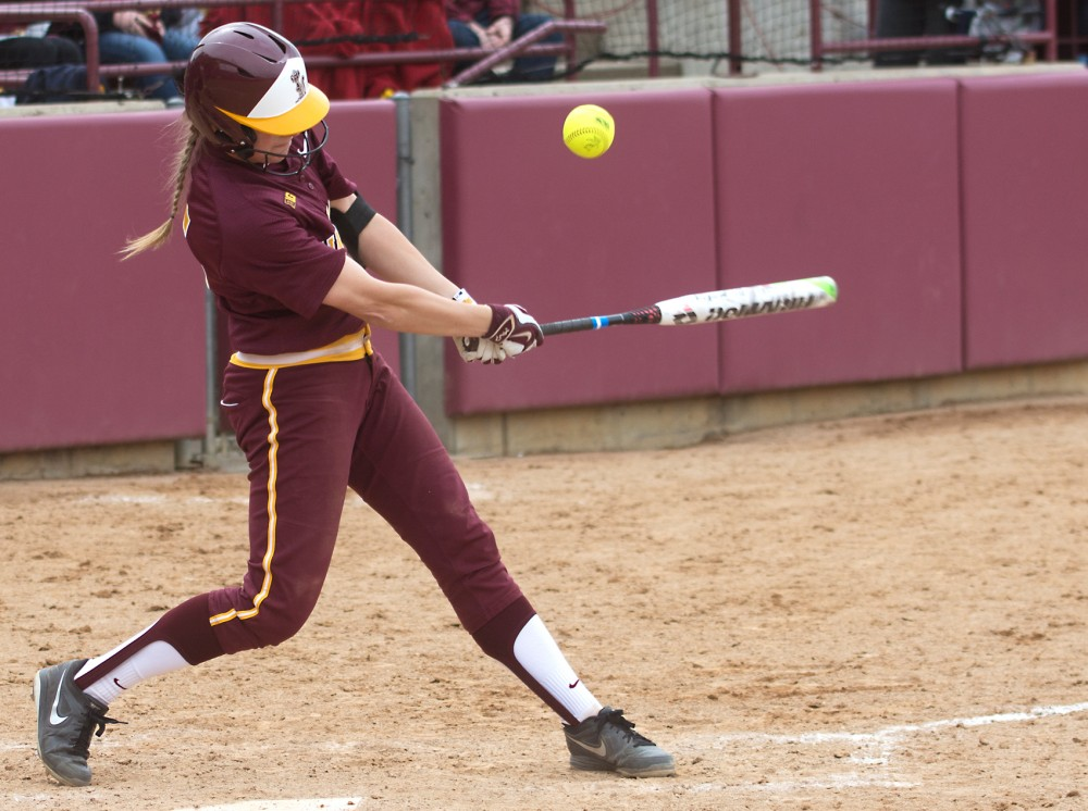 Freshman Erika Rozell fouls off a pitch at Jane Sage Cowles Stadium on Saturday, April 4, 2015.