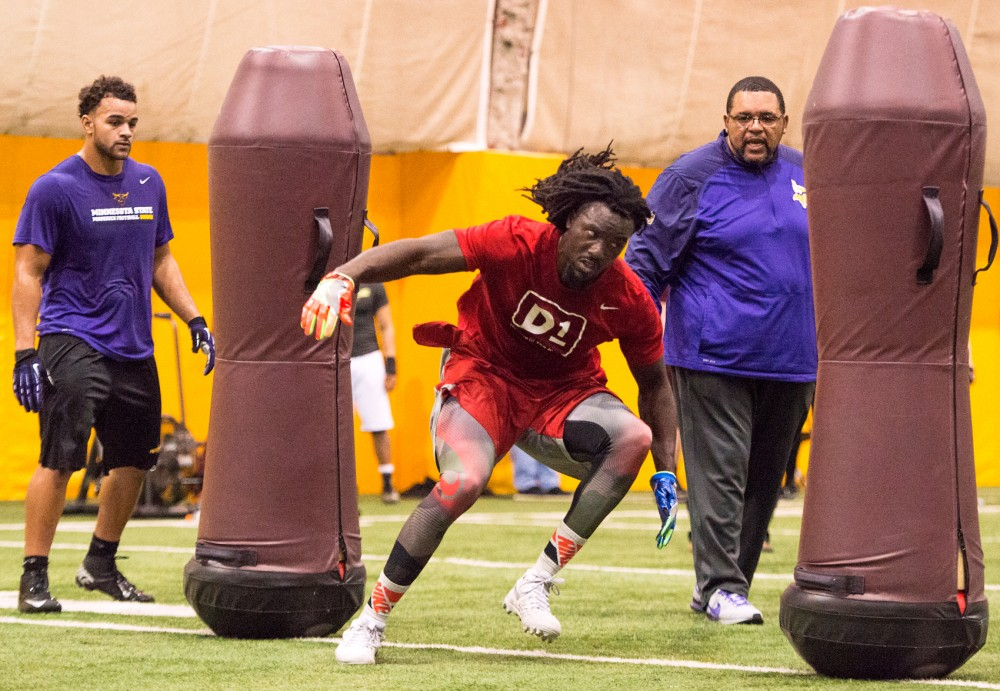Vikings defensive line coach Andre Patterson runs De'Vondre Campbell through a drill during Pro Day at the Gibson-Nagurski Football Complex on Monday.