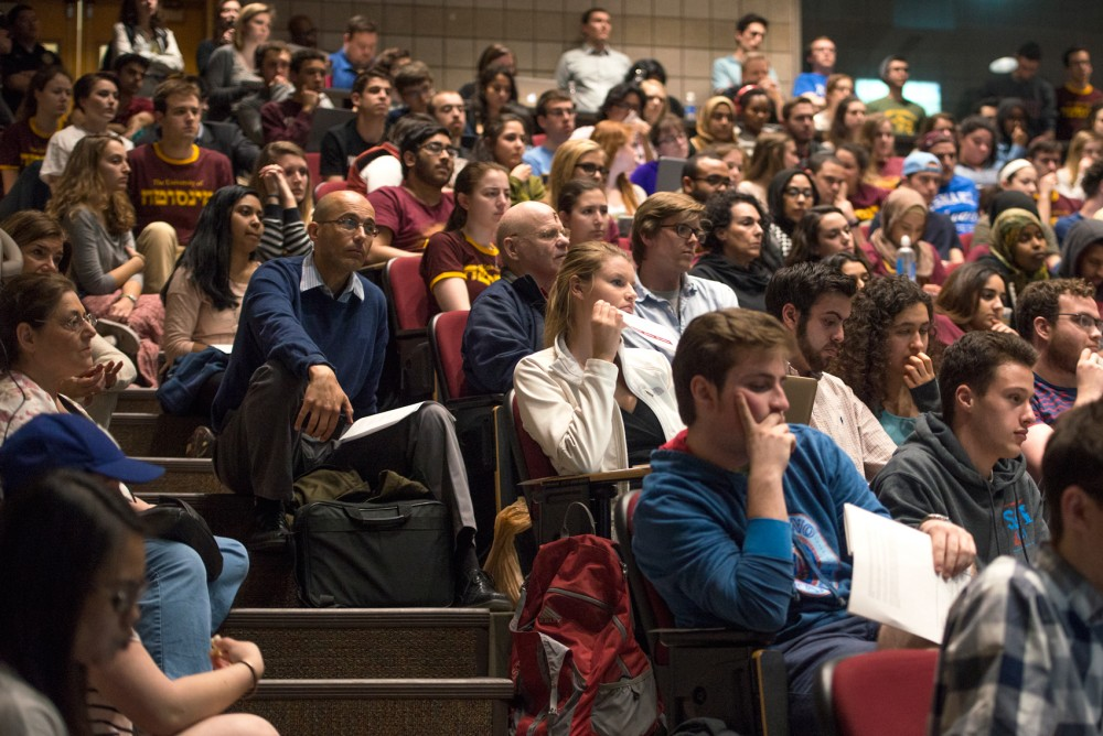 MSA members, students, and concerned citizens fill room 3-120 of the Molecular and Cellular Biology building on Tuesday for to be a part of the discussion on two proposed  resolutions regarding divestment at the University.