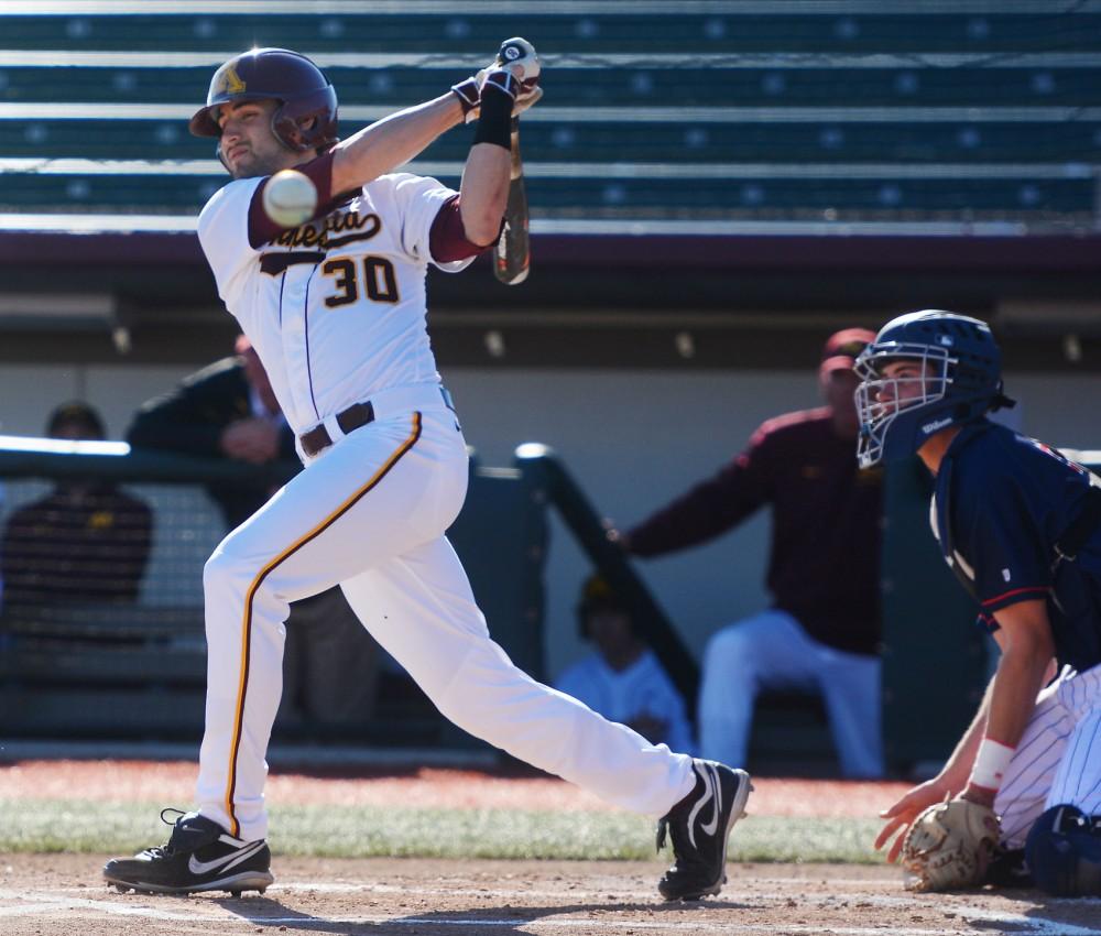 Gophers outfielder Dan Motl swings at Siebert Field, March 31.