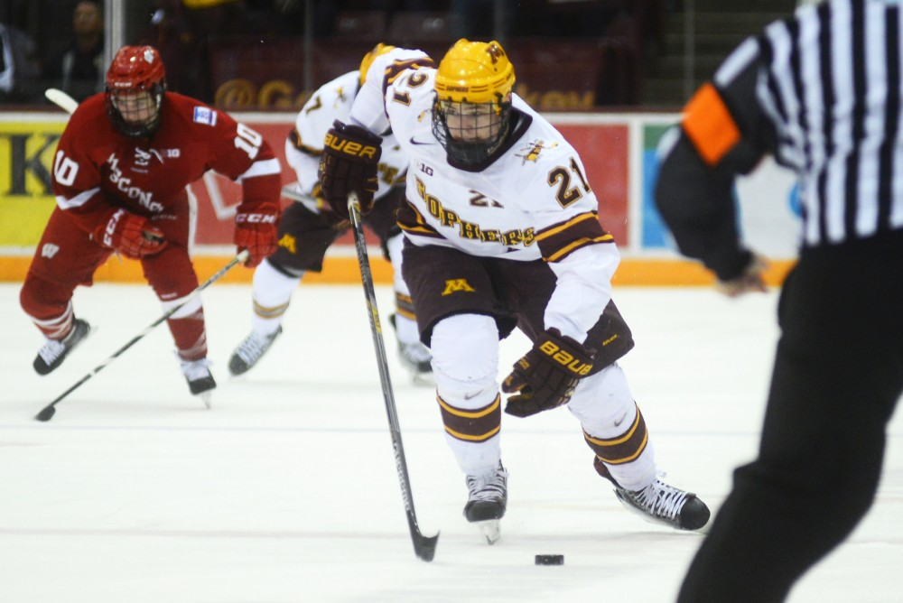 Gophers forward Connor Reilly races the puck down the ice at Mariucci Arena on Jan. 17, 2015.