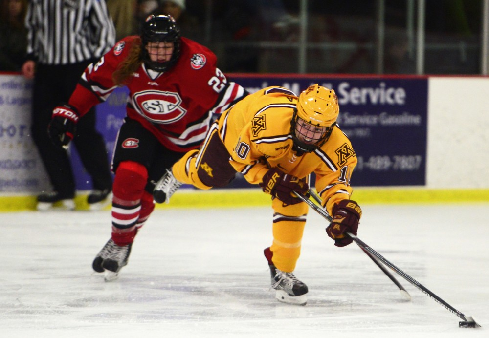 Cara Piazza keeps her balance as she attempts a shot at the the 2015 U.S. Hockey Hall of Fame Museum game at the Roseville Skating Center on Friday, Dec. 11, 2015. The Gophers defeated St.Cloud State 7-0.