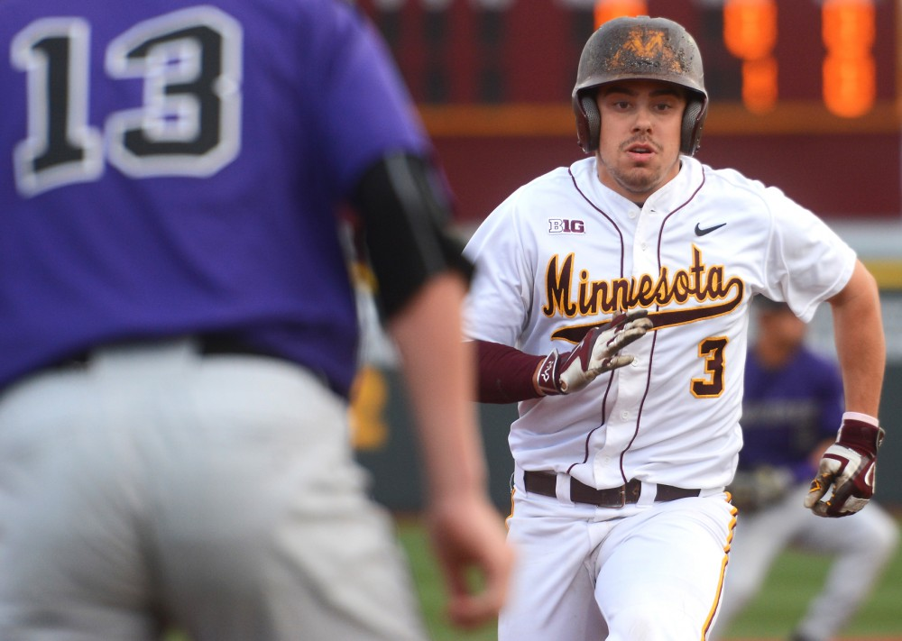 Gophers outfielder Matt Fiedler runs to third base at Siebert Field on April 28.