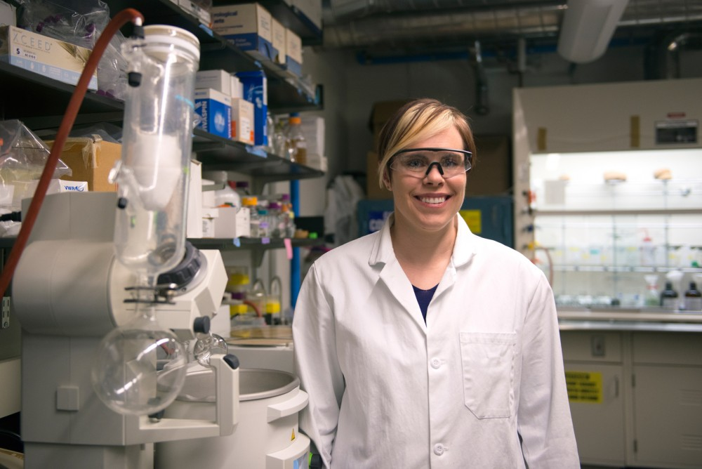 Chemistry professor Dr. Erin Carlson poses for a portrait in her lab on Friday. Carlson was recently awarded the Presidential Early Career Awards for Scientists and Engineers by President Barak Obama.