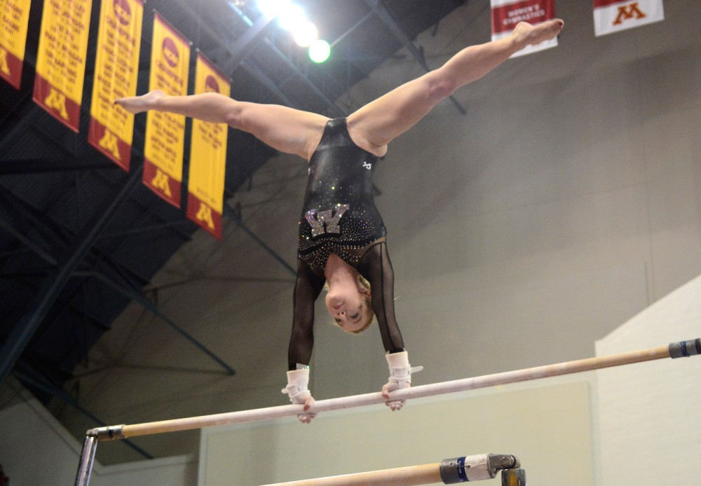Senior Lindsay Mable performs on the uneven bars at the Sports Pavilion on Feb. 27.